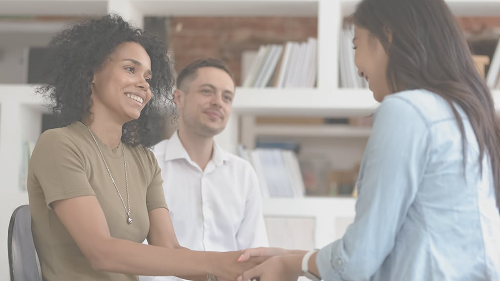 A woman shaking hands with a mediator